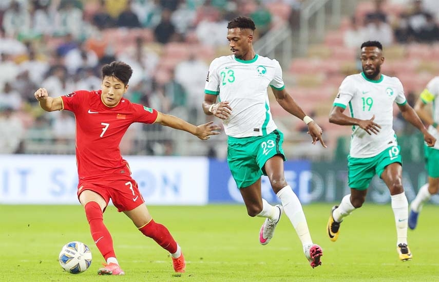 Wu Lei (left) of China competes during the FIFA World Cup Qatar 2022 Asian qualification football match between China and Saudi Arabia in Jeddah, Saudi Arabia on Tuesday.