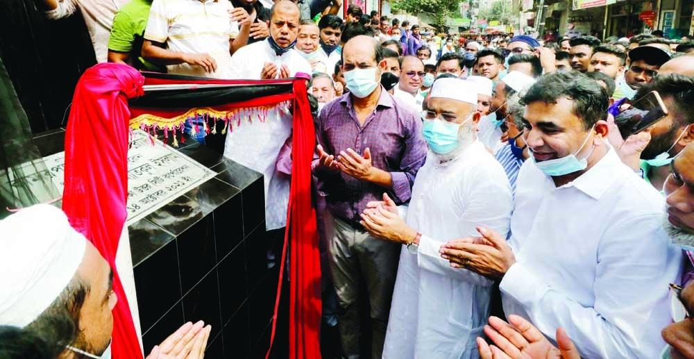 Dhaka North City Corporation Mayor Atiqul Islam inaugurates Kamarpara Koborsthan Road on Thursday.