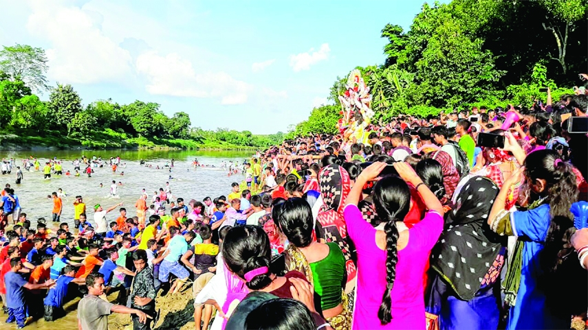 The farewell ceremony of Goddes Durga with the abandonment of her idol into the Feni River was held with tears of thousands of devotees from both sides of the Bangladesh-India border at Ramgarh Anandapara Ghat on the Feni River on Friday.