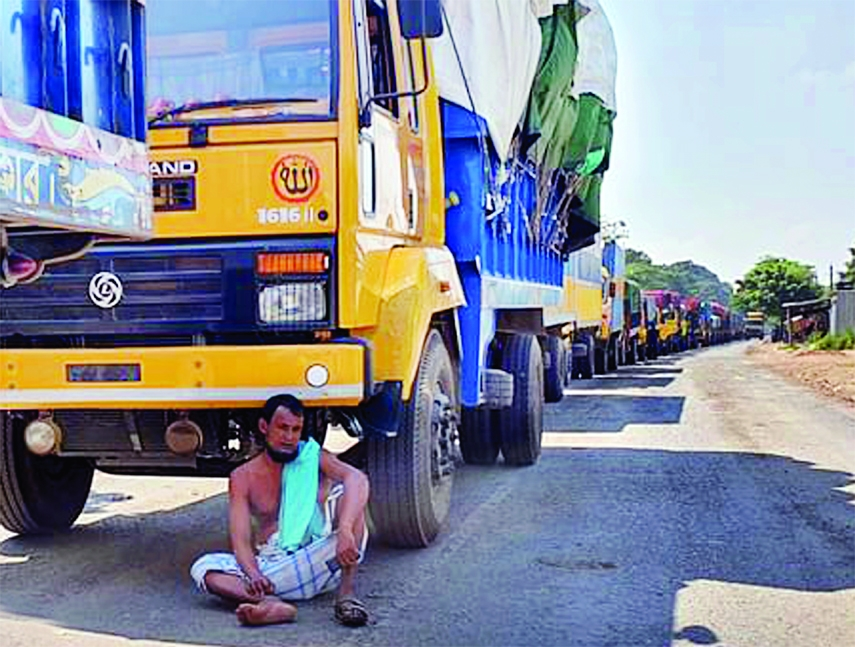 Hundreds of trucks get clogged in long tailback at Daulotdia Ghat in Rajbari on Friday due to ferry crisis.