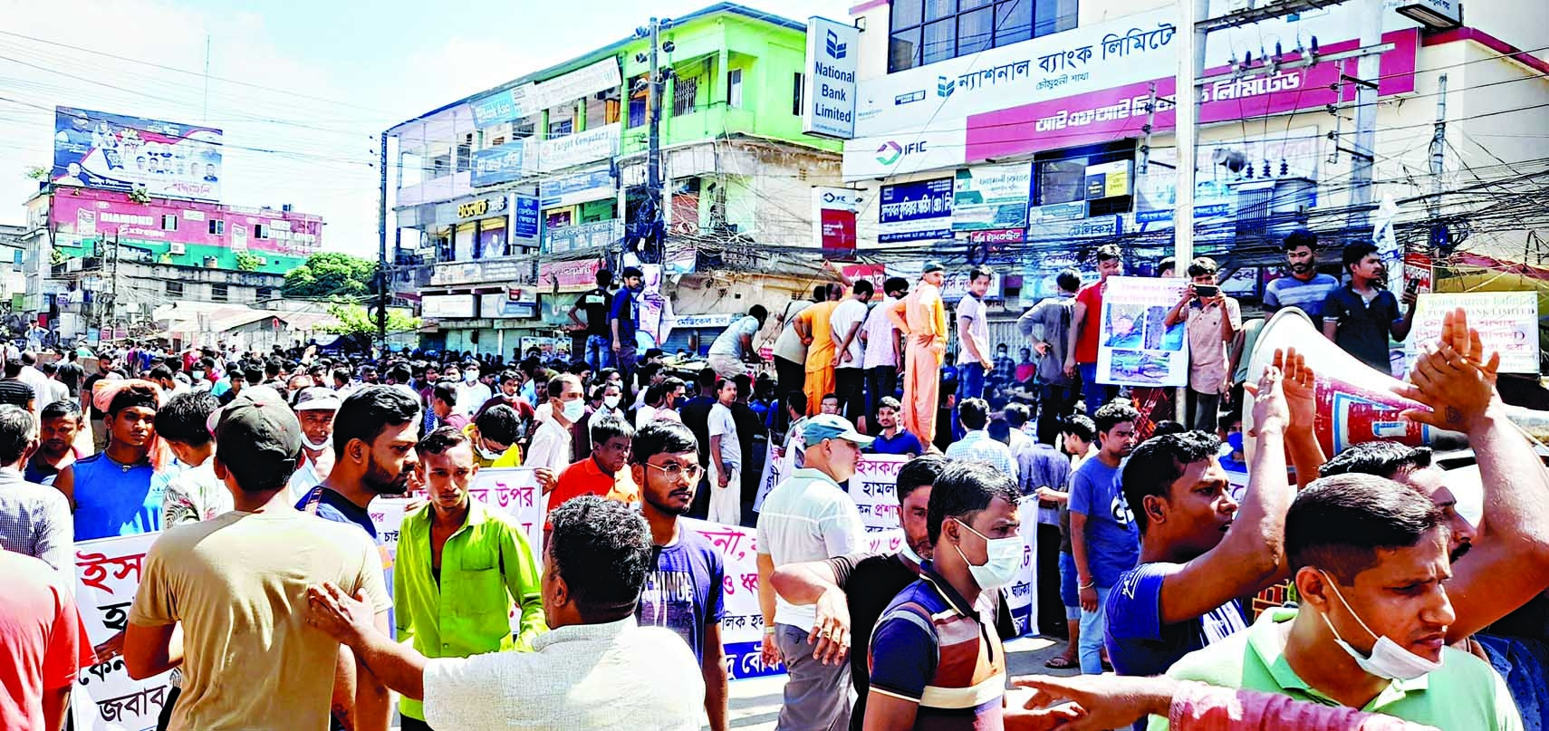 Members of Hindu community bring out a procession at Chowmuhani Bazar in Begumganj upazila of Noakhali district on Saturday defying authorities' ban on meetings and public gatherings.