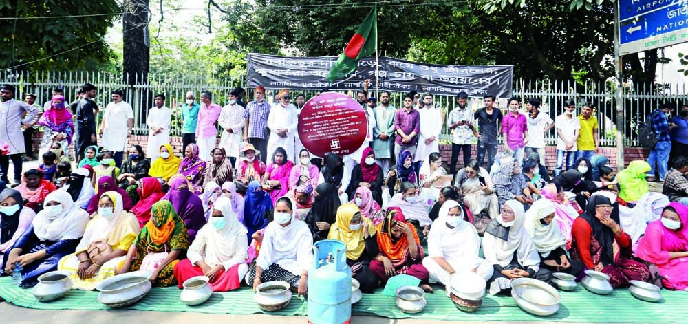 A cross section of people stage a rally in front of the National Museum in the capital on Saturday protesting the rise in prices of essential commodities.