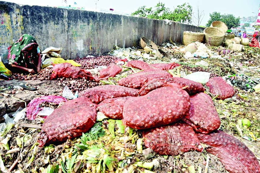 Sacks of rotten onion dumped at Shyambazar area in the capital on Sunday. This indicates either hoarding or poor management of onion stock.