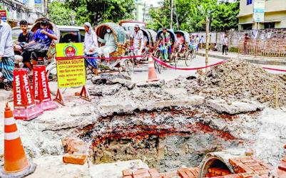 A significant portion of the Outer Circular Road at Rajarbagh in the capital has been dug up by the Dhaka South City Corporation for renovations, interrupting the flow of traffic on the busy thoroughfare. This photo was taken on Saturday.