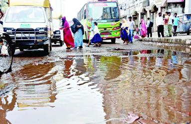 The dilapidated condition of road at Chankhar Pool near Dhaka Medical College in city has caused untold sufferings to commuters and pedestrians as well. This photo was taken on Thursday.