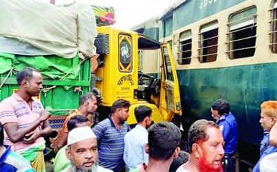 Inter-city passenger train 'Dhalarchar Express' collided with a truck at a level crossing resulting in a traffic jam for four hours on Ishawardi-Pabna highway on Thursday.
